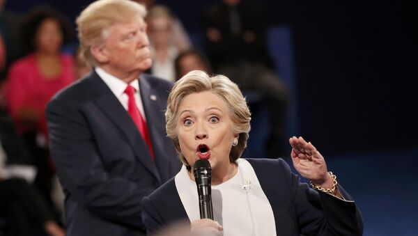 Democratic U.S. presidential nominee Hillary Clinton speaks during their presidential town hall debate with Republican U.S. presidential nominee Donald Trump at Washington University in St. Louis, Missouri, U.S., October 9, 2016. - Sputnik International