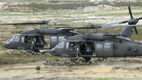 U.S. Army Black Hawk helicopters support soldiers during the NATO Noble Jump exercise on a training range near Swietoszow Zagan, Poland. Polish leaders say the country is buying Polish-made Black Hawk helicopters as it modernizes the army. - Sputnik International
