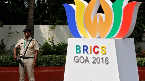 A security personnel stands guard outside one of the venues of BRICS (Brazil, Russia, India, China and South Africa) Summit, in Benaulim in the western state of Goa, India, October 14, 2016. - Sputnik International