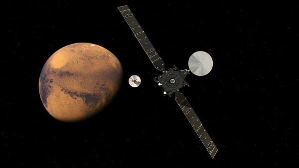The ExoMars Trace Gas Orbiter and its entry, descent and landing demonstrator module, Schiaparelli, approaching Mars. - Sputnik International