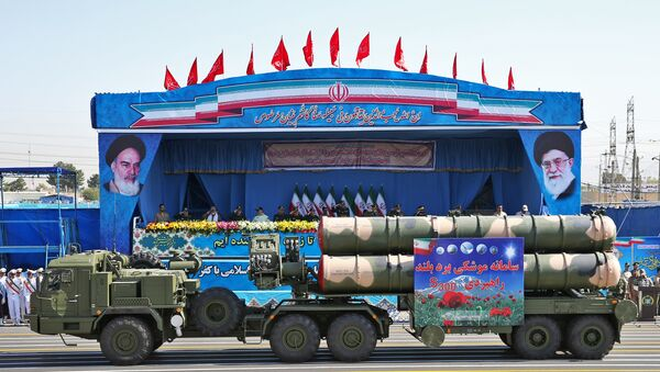 In front of the portraits of supreme leader Ayatollah Ali Khamenei, right, and late revolutionary founder Ayatollah Khomeini, left, a long-range, S-300 missile system is displayed by Iran's army during a military parade marking the 36th anniversary of Iraq's 1980 invasion of Iran, in front of the shrine of late revolutionary founder Ayatollah Khomeini, just outside Tehran, Iran, Wednesday, Sept. 21, 2016 - Sputnik International