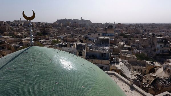 A view taken with a drone shows the minaret of Osama Bin Zayed mosque along with damaged buildings in the old city of Aleppo, Syria, October 13, 2016 - Sputnik International