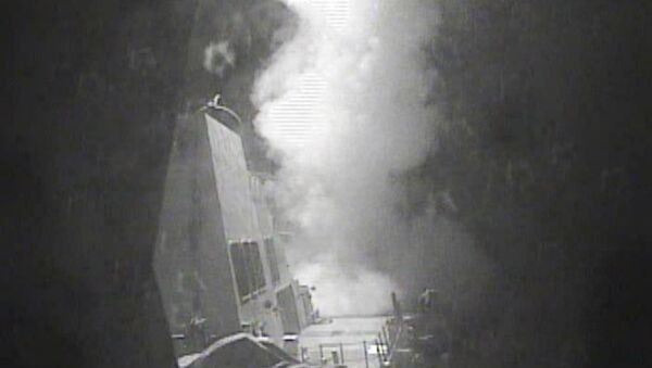 In this Thursday Oct. 13 photo released by US Navy, the guided missile destroyer USS Nitze (DDG 94) launches a strike against coastal sites in Houthi-controlled territory on Yemen's Red Sea coast - Sputnik International