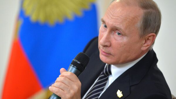 Russian President Vladimir Putin during the news conference following the meeting of the BRICS member states' leaders at Taj Exotica hotel in Goa, the Republic of India, October 16, 2016 - Sputnik International