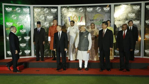 Brazilian President Michel Temer, left, walks to join leaders of BRICS countries, from left bottom row, Russian President Vladimir Putin, Indian Prime Minister Narendra Modi, Chinese President Xi Jinping, and South African President Jacob Zuma and BIMSTEC leaders, second row from left, Nepalese Prime Minister Pushpa Kamal Dahal, Bhutanese Prime Minister Tshering Tobgay, Sri Lankan President Maithripala Sirisena, Bangladesh Prime Minister Sheikh Hasina, Myanmar's Foreign Minister Aung San Suu Kyi and Thailand's Vice Minister for Foreign Affairs Virasakdi Futrakul, for a group photo at the BRICS and BIMSTEC, or Bay of Bengal Initiative for Multi-Sectoral Technical and Economic Cooperation, summit in Goa, India, Sunday, Oct. 16, 2016 - Sputnik International