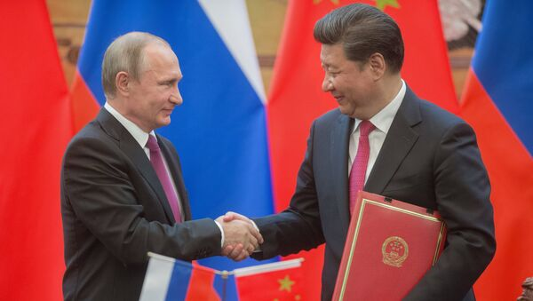 Russian President Vladimir Putin, left, and President of the People's Republic of China Xi Jinping during a signing ceremony of documents following their talks in Beijing - Sputnik International
