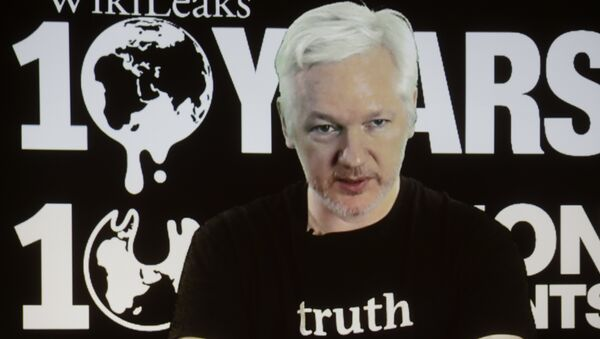 In this Oct. 4, 2016 file photo, WikiLeaks founder Julian Assange participates via video link at a news conference marking the 10th anniversary of the secrecy-spilling group in Berlin. WikiLeaks said on Monday, Oct. 17, 2016, that Assange's internet access has been cut by an unidentified state actor. - Sputnik International