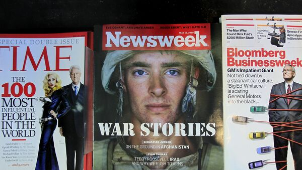 Newsweek magazine is displayed on a shelf at a news stand at South Station in Boston, Wednesday, May 5, 2010. The Washington Post Co. is putting Newsweek up for sale in hopes that another owner can figure out how to stem losses at the 77-year-old weekly magazine. - Sputnik International