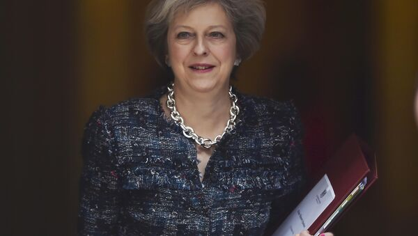 Britain's Prime Minister Theresa May leaves Number 10 Downing Street to attend Prime Minister's Questions at parliament in London, Britain October 19, 2016. - Sputnik International
