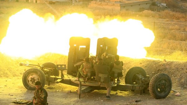 Peshmerga forces fire an anti-aircraft gun towards Islamic state militants positions in the town of Naweran near Mosul, Iraq, October 20, 2016. - Sputnik International