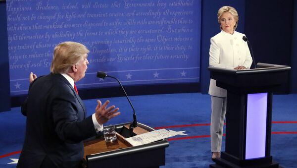 Democratic presidential nominee Hillary Clinton and Republican presidential nominee Donald Trump debate during the third presidential debate at UNLV in Las Vegas - Sputnik International