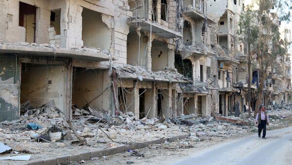 A man walks past damaged buildings in the rebel held besieged al-Sukkari neighbourhood of Aleppo, Syria October 19, 2016. - Sputnik International