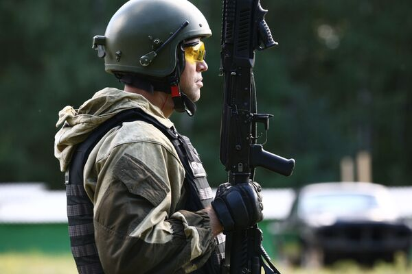 Member of the Open Championship among Special Forces troops on the practical shooting from small arms at the shooting range in the village of Yavas, the Republic of Mordovia. - Sputnik International