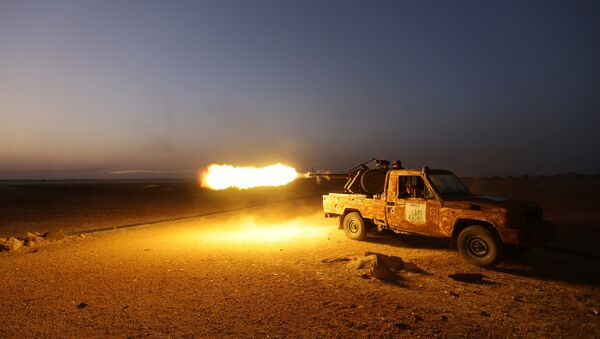 Rebel fighters shoot their weapon towards Syria Democratic Forces (SDF) controlled Tell Rifaat town, northern Aleppo province, Syria October 22, 2016 - Sputnik International