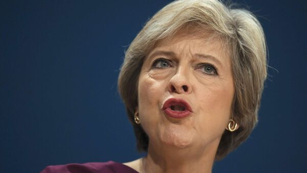 Britain's Prime Minister Theresa May gives her speech on the final day of the annual Conservative Party Conference in Birmingham, Britain, October 5, 2016. - Sputnik International
