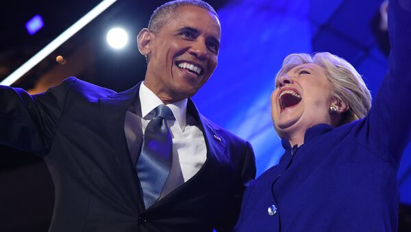 US President Barack Obama (L) hugs US Presidential nominee Hillary Clinton during the third night of the Democratic National Convention at the Wells Fargo Center in Philadelphia, Pennsylvania, July 27, 2016 - Sputnik International