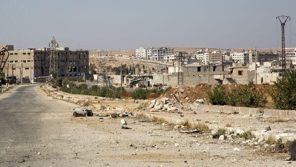 A general view shows a damaged road and abandoned buildings in Aleppo's rebel-held Kalasa neighbourhood - Sputnik International
