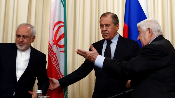 Russian Foreign Minister Sergei Lavrov (C) and his counterparts Walid al-Muallem (R) from Syria and Mohammad Javad Zarif from Iran attend a news conference in Moscow, Russia, October 28, 2016. - Sputnik International