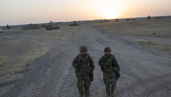 US soldiers walking at the Qayyarah military base during the ongoing operation to recapture the last major Iraqi city under the control of the Islamic State (IS) group jihadists. (File) - Sputnik International
