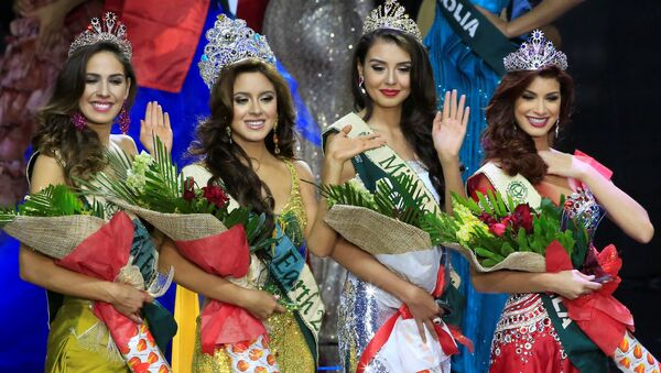 Miss Ecuador Katherine Espin (2nd L), crowned this year's Miss Earth, Miss Colombia Michelle Gomez (2nd R), won as Miss Earth Air, Miss Brazil Bruna Zanardo (L), as Miss Earth Fire and Miss Venezuela Stephanie De Zorzi, won as Miss Earth Water, wave to photographers during the Miss Earth 2016 International coronation night at a mall in Pasay city, metro Manila, Philippines - Sputnik International