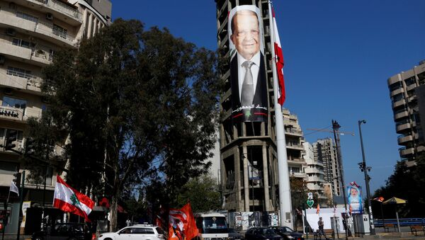A picture of Christian politician and FPM founder Michel Aoun is seen on a building prior to presidential elections in Beirut, Lebanon October 30, 2016 - Sputnik International