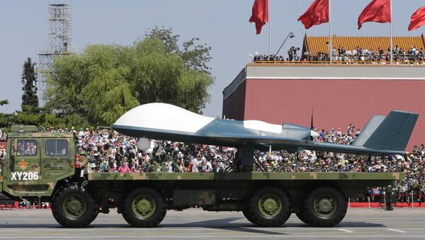 A military vehicle carries a Pterodactyl I unmanned aerial vehicle past the Tiananmen Gate during a military parade to commemorate the 70th anniversary of the end of World War II in Beijing Thursday, Sept. 3, 2015 - Sputnik International