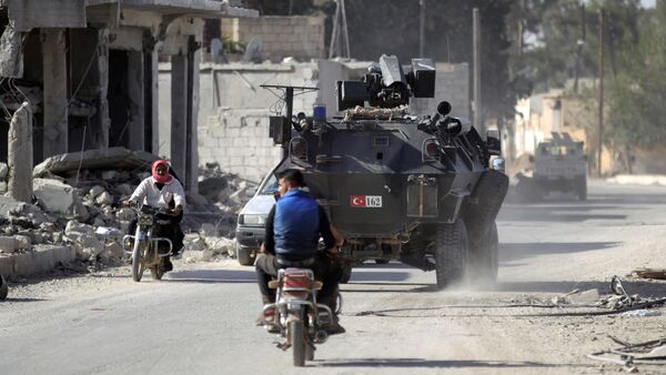 Men ride motorbikes past a Turkish armored carrier in the northern Syrian rebel-held town of al-Rai, in Aleppo Governorate, Syria, October 5, 2016 - Sputnik International