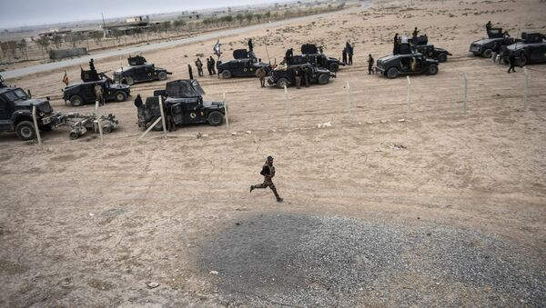 Members of the Iraqi Counter Terrorism Service (CTS) drive near the village of Bazwaya, on the eastern edges of Mosul, tightening the noose on Mosul as the offensive to retake the Islamic State group stronghold entered its third week on October 31, 2016 - Sputnik International