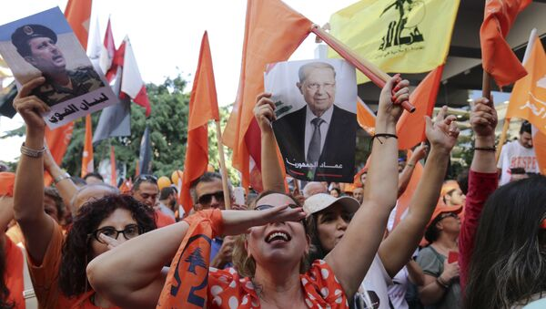 Supporters of Christian leader Michel Aoun hold his picture and Free Patriotic Movement, Lebanese flags and Hezbollah flag celebrate the election of the new President Michel Aoun, in Beirut, Lebanon, Monday, Oct. 31, 2016 - Sputnik International