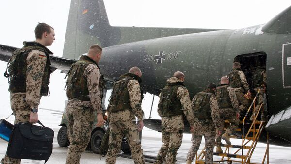 German soldiers enter a Transall C-160 cargo plane at the military airbase Penzing, 50 kilometers (28 miles) west of Munich, southern Germany, on Saturday, Dec. 18, 2004 - Sputnik International