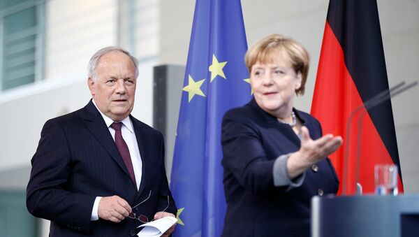 German Chancellor Angela Merkel and Swiss President Johann Schneider-Ammann attend a media conference in the chancellery in Berlin, Germany, November 2, 2016. - Sputnik International