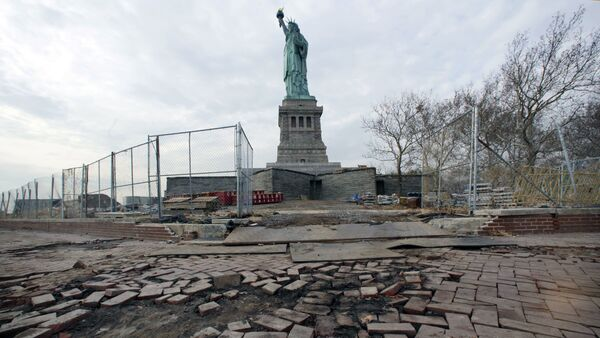 The Statue of Liberty stands beyond parts of a brick walkway damaged in Superstorm Sandy on Liberty Island in New York (File) - Sputnik International