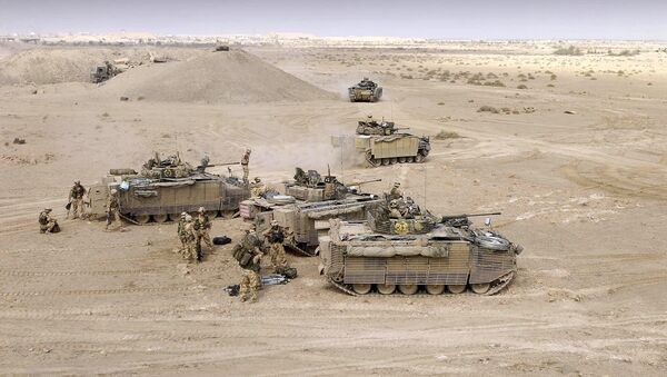 British soldiers of the Black Watch supported, by a detachment of Royal Marines and mortars, advance into an area of Operations east of the River Euphrates in Iraq, Sunday Nov. 7, 2004 - Sputnik International