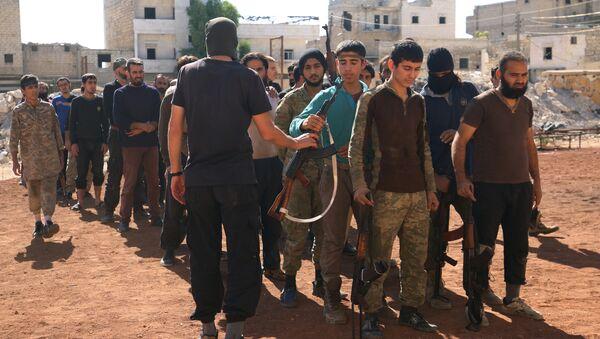 Rebel fighters part of the Jabhat Fatah al Sham, attend military training in the besieged rebel held Aleppo, Syria October 26, 2016 - Sputnik International