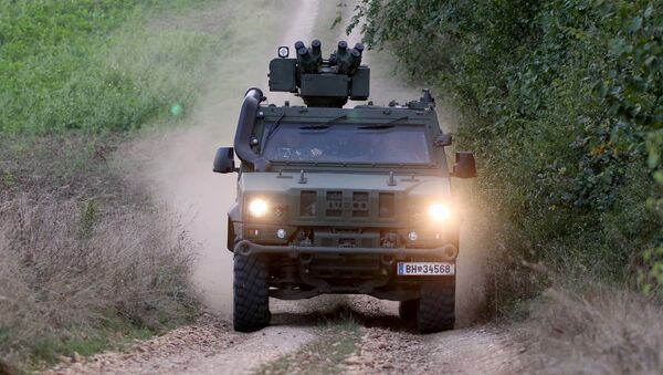 A vehicle of the Austrian army drives to patrol on the border for illegally entering migrants between Hungary and Austria in Nickelsdorf, Austria, Tuesday, Sept. 20, 2016 - Sputnik International