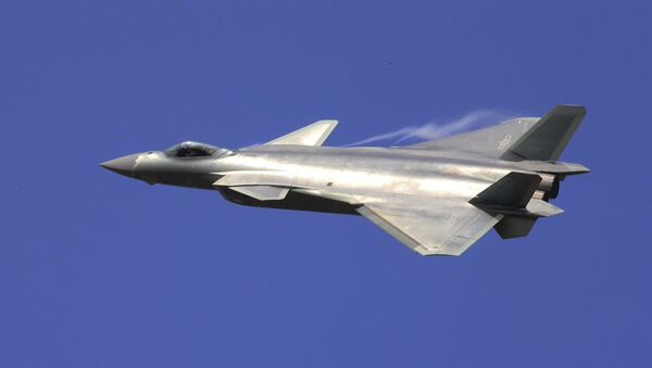 In this photo provided by China's Xinhua News Agency, the J-20 stealth fighter jet flies at the China International Aviation and Aerospace Exhibition in Zhuhai on Tuesday, 1 November 2016. - Sputnik International
