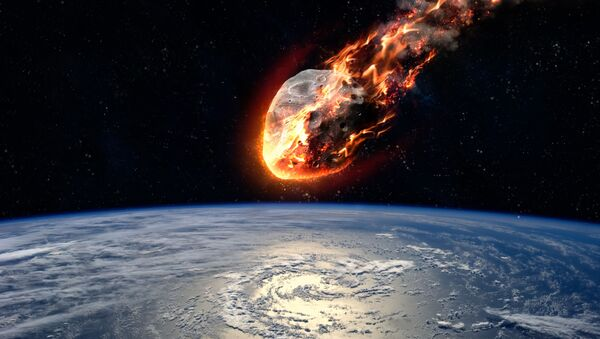 Meteor glowing as it enters the Earth's atmosphere. Elements of this image furnished by NASA. - Sputnik International