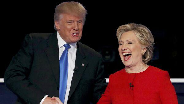 Republican U.S. presidential nominee Donald Trump shakes hands with Democratic U.S. presidential nominee Hillary Clinton - Sputnik International