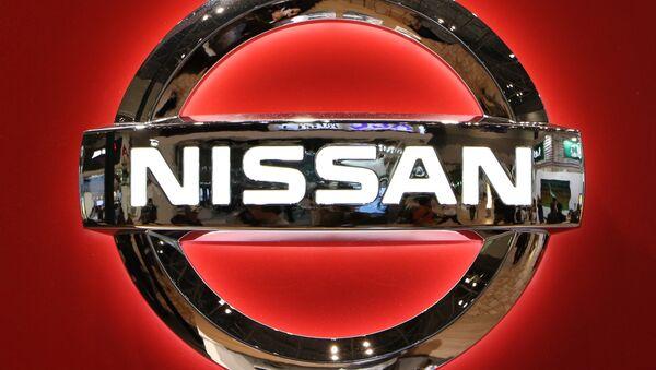 The logo of Japanese auto giant Nissan Motor is seen at the Tokyo Motor Show on November 2, 2015. - Sputnik International