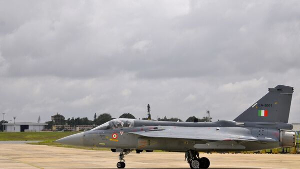 An Indian Air Force (IAF) pilot taxies a newly commissioned Tejas or Light Combat Aircraft (LCA) on a runway in Bangalore during a ceremony in the southern Indian city. (File) - Sputnik International