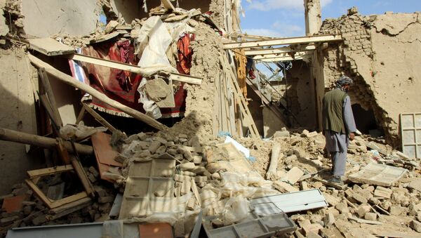 An Afghan man inspects a house destroyed during an air strike called in to protect Afghan and U.S. forces during a raid on suspected Taliban militants, in Kunduz, Afghanistan - Sputnik International