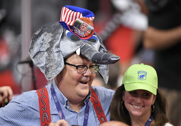 A Donald Trump supporter wears an elephant-shaped hat during the opening day of the Republican National Convention in Cleveland, Monday, July 18, 2016 - Sputnik International