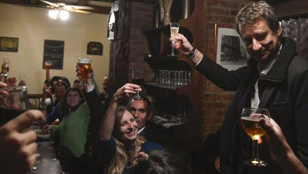 Newly elected French green party Europe-Ecologie-Les Verts (EELV) candidate for the 2017 presidential election Yannick Jadot (R) toasts as he celebrates with supporters after winning the EELV primaries, in a restaurant in Paris on November 7, 2016, Jadot won the second round of voting for the EELV primaries ahead of the 2017 French presidential election on November 7 - Sputnik International