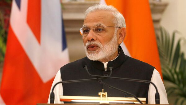 India's Prime Minister Narendra Modi reads a joint statement with his British counterpart Theresa May (unseen) at Hyderabad House in New Delhi, India, November 7, 2016 - Sputnik International