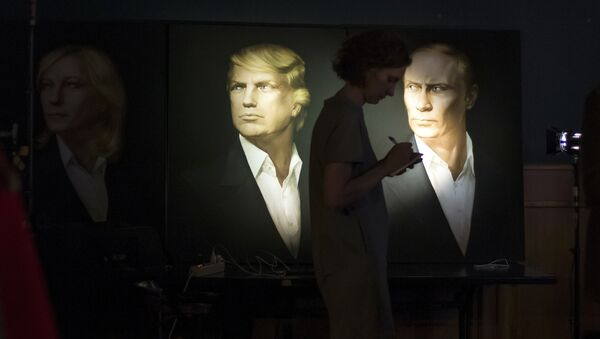 A journalist writes a material as she watches a live telecast of the U.S. presidential election standing at portraits of U.S. presidential candidate Donald Trump and Russian President Vladimir Putin in the Union Jack pub in Moscow, Russia, Wednesday, Nov. 9, 2016 - Sputnik International
