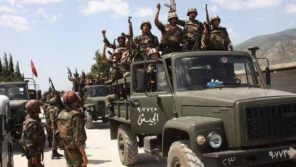 Syrian army soldiers standing on their military trucks chanting slogans in support of Syrian President Bashar Assad, as they enter a village near the town of Jisr al-Shughour, north of Damascus, Syria (File) - Sputnik International