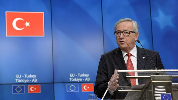 European Union Commission President Jean-Claude Juncker talks to the media at the end of an European Union Summit held at the EU Council building in Brussels, Friday March 18, 2016. - Sputnik International
