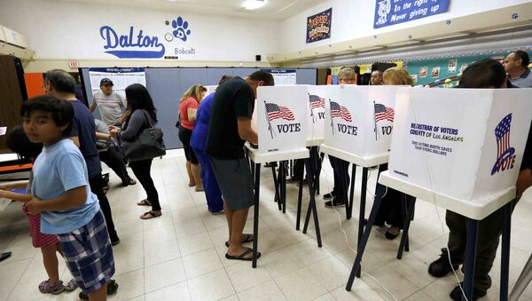 Voters cast their ballots in the Dalton Elementary School after the polling station in Azusa, California, U.S. was reopened following a shooting in the area during the U.S. presidential election November 8, 2016 - Sputnik International
