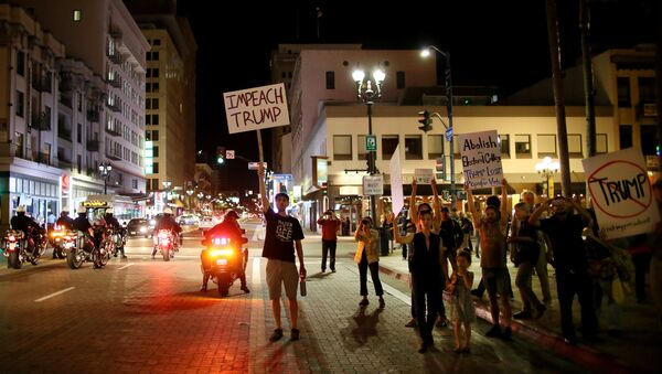 Demonstrators walk through Downtown San Diego in protest to the election of Republican Donald Trump as the president of the United States in San Diego, California, U.S. November 9, 2016 - Sputnik International