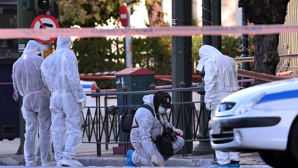 Police officers investigate at the front of the French embassy after two motorcyclists threw a hand granade injuring the guard early in central Athens on November 10, 2016 - Sputnik International